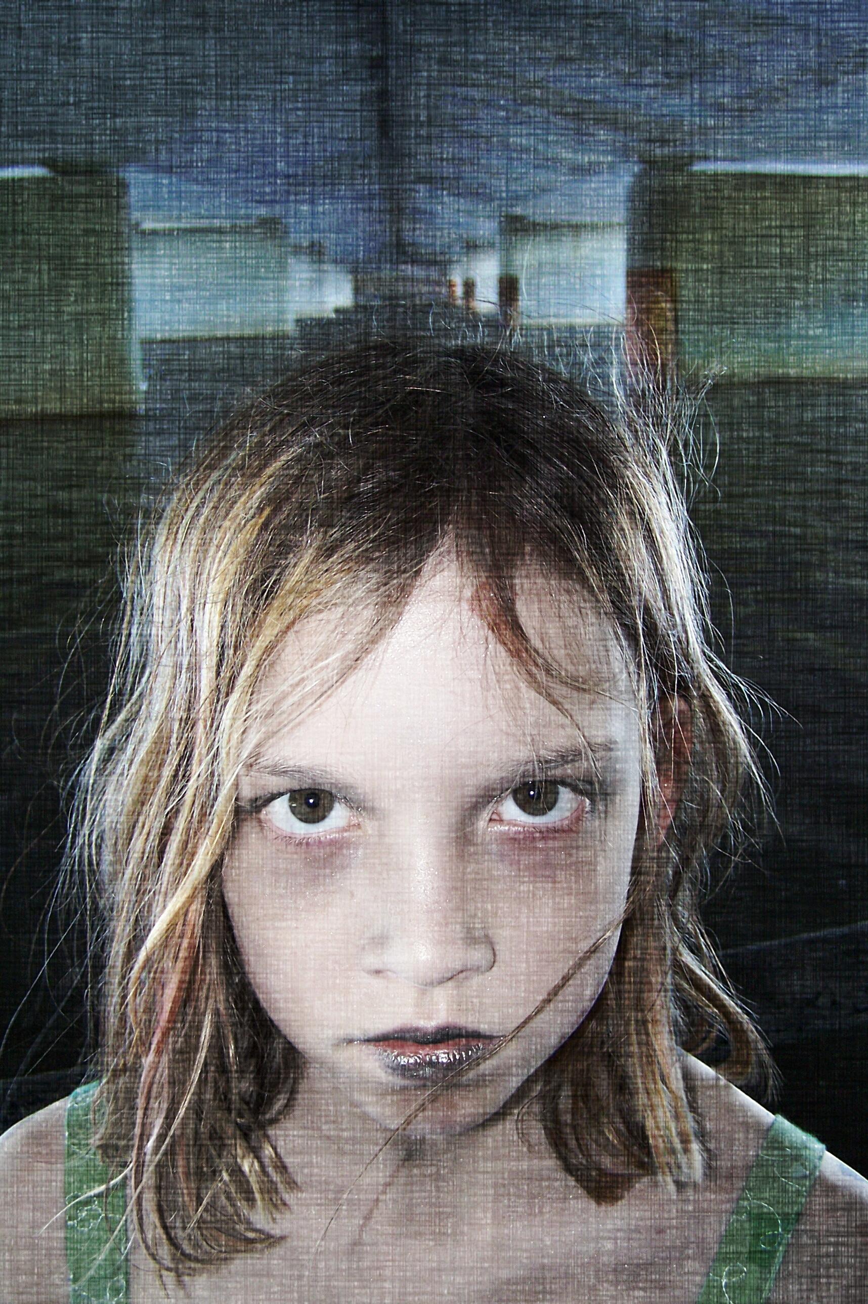 Creepy girl with large eyes under bridge